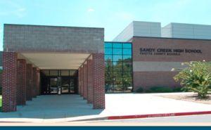 news_stock-art_04-09-15_Sandy-Creek-High-School-entrance