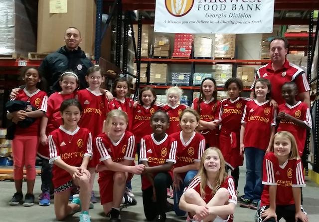 Soccer team helps food bank
