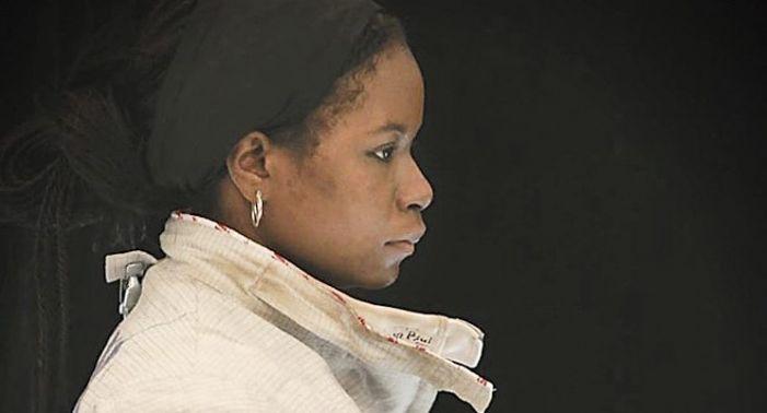 Lena Johnson aims her sword toward the Olympics
