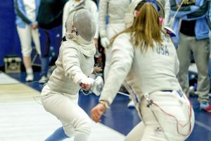 Peachtree City native Lena Johnson (R) lunges for a point in a fencing match at the Ivy League Championships in February. Photo/Mike McLaughlin.