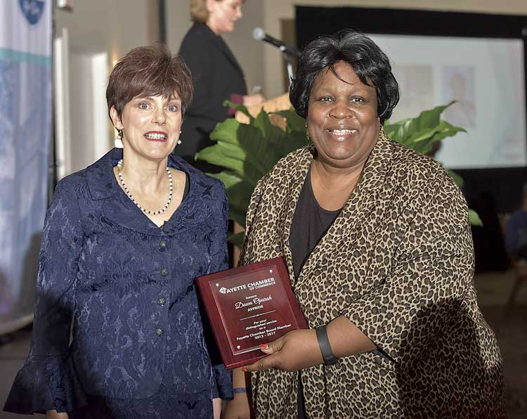 Dawn Oparah (R) with outgoing Chair Kim Schnoes. Photo/Roger Sibaja, Gobi Photography.