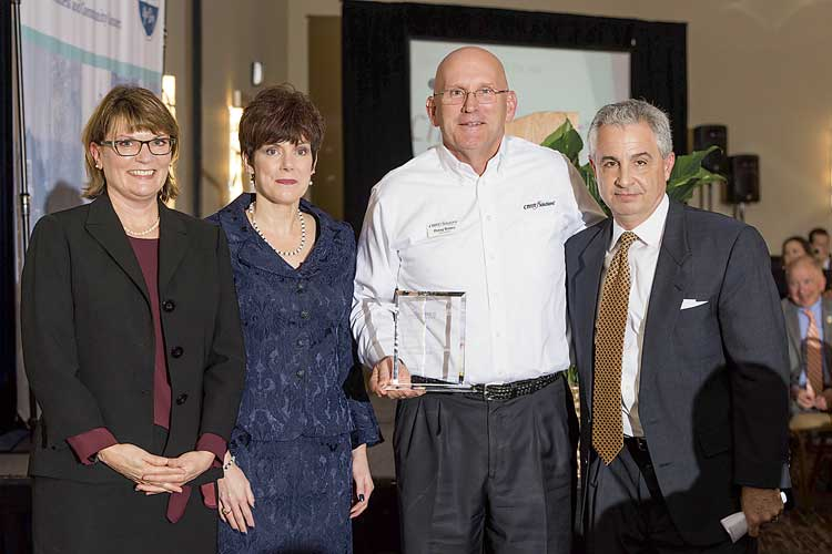 Small Business of the Year is CMIT Solutions of Fayette/Coweta. Above, Chamber CEO Carlotta Ungaro, outgoing chair Kim Schnoes, CMIT's Doug Bates and Christian City CEO Len Romano. Photo/Roger Sibaja, Gobi Photography.