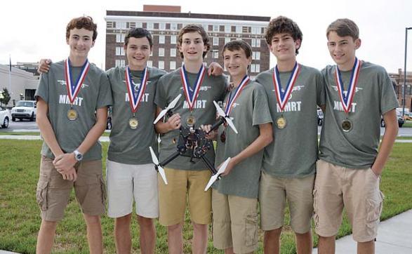 Wearing their medals and showing off the drone are (L-R) Matt Harmon, Robbie van Zyl, Andrew Walter, Parker Korn, Ian Buckalew, Marcus DiBatista. Photo/Gerrie van Zyl.
