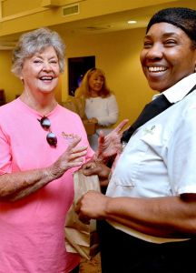 Christian City Board of Trustees member, Audrey Bates (left) provides a lunch to Christian City dietary aide, Marie Regis. Photo/Larry Regier.